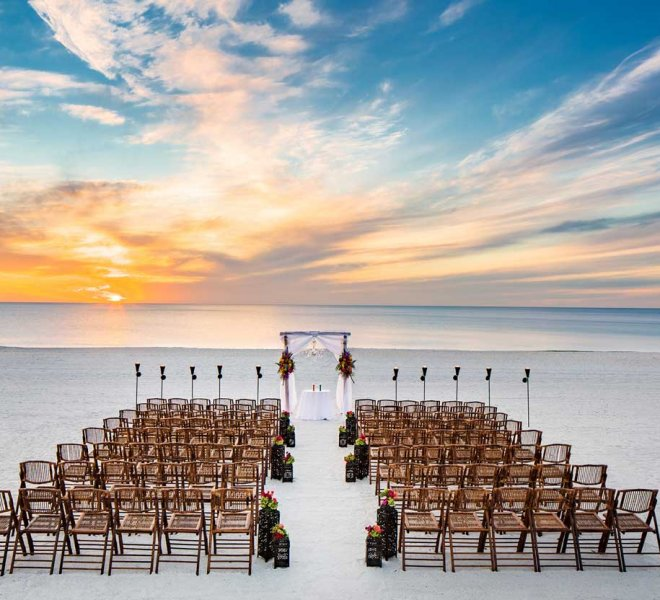 Beach front wedding ceremony by Foreman Productions, Inc.