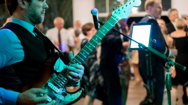 Lead guitarist of Foreman's 5 performing at a Southwest Florida private event reception