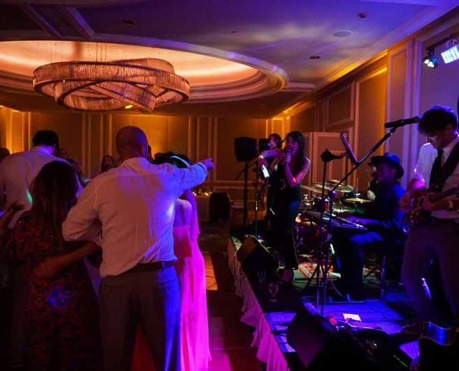 The Foreman's 5 entertaining a crowd at a Naples Florida wedding reception