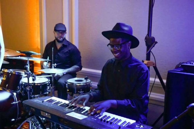 A Foreman's 5 band member playing the piano at a Southwest Florida wedding reception managed by Foreman Productions, Inc.
