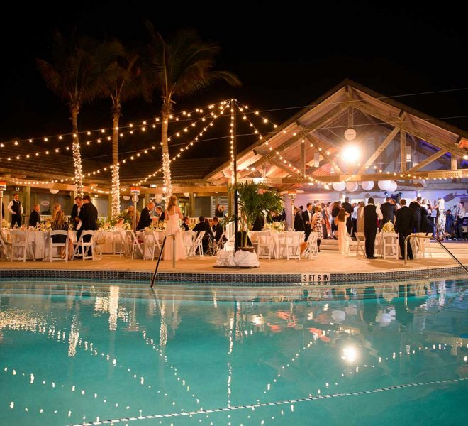 Pool side wedding reception managed by Foreman Productions, Inc.