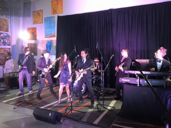 Winslow and the Rockefellers rehearsing for a private event in Southwest Florida